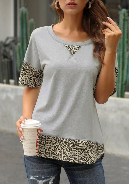 Model poses wearing grey leopard patchwork half sleeves loose top
