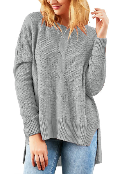 Model poses wearing grey ribbed knit textured side-slit sweater