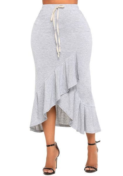Model poses wearing grey ruffle asymmetrical hem long bodycon skirt