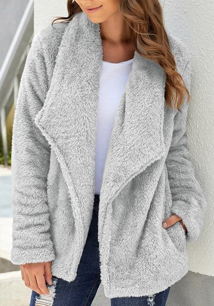 Model poses wearing grey side-pockets lapel fleece coat
