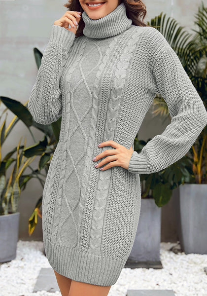 Model poses wearing grey turtleneck cable knit pullover sweater dress