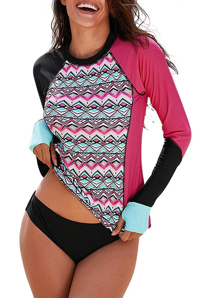 Model poses wearing hot pink geometric-print long sleeves color block rash guard
