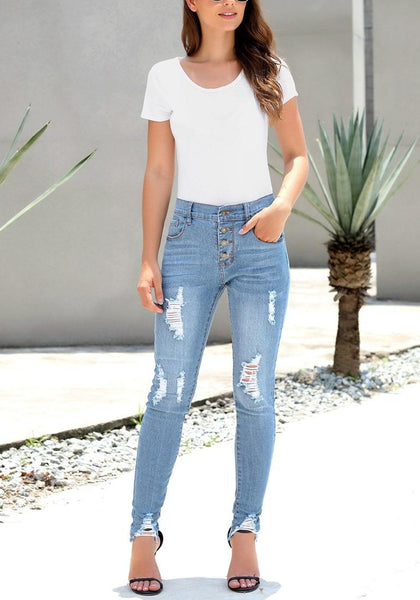 Model poses wearing light blue high-rise ripped denim buttoned denim jeans