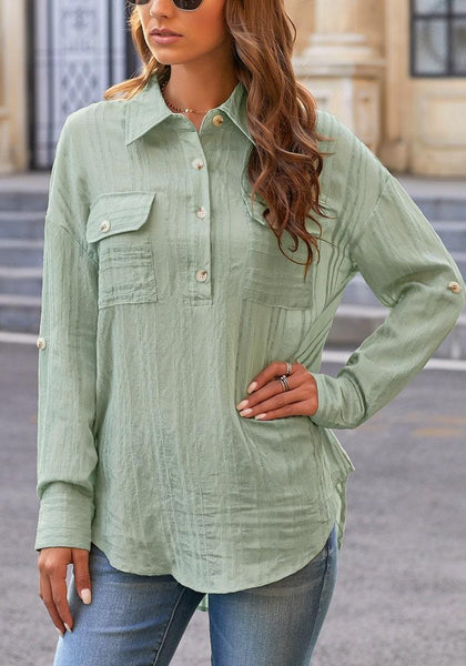Model poses wearing light green long sleeves half button-up tunic shirt