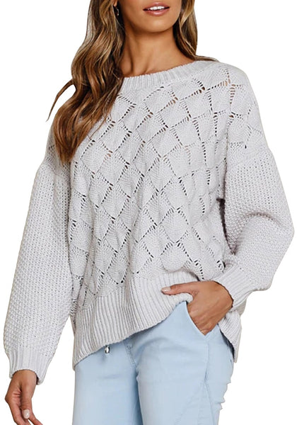 Model poses wearing light grey ribbed crochet knit oversized sweater