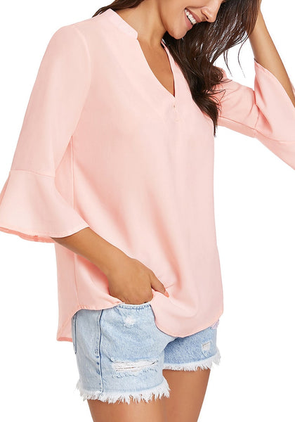 Model poses wearing light pink V-neck flare sleeves loose chiffon blouse