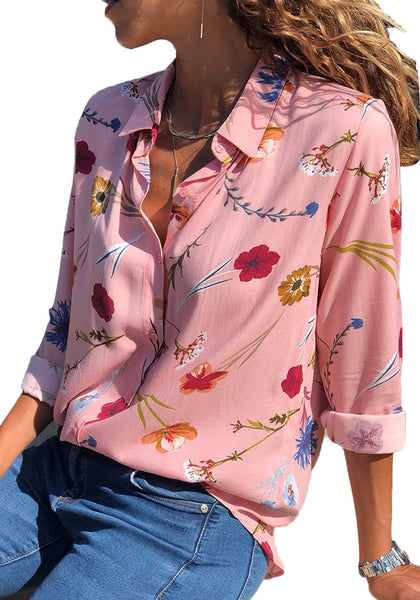 Model poses wearing light pink floral long sleeves collared button-up top