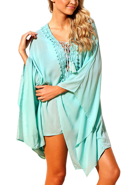 Model poses wearing mint lace-up batwing sleeves beach cover-up