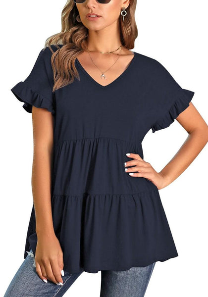 Model poses wearing navy V-neck ruffled short sleeves tiered tunic top