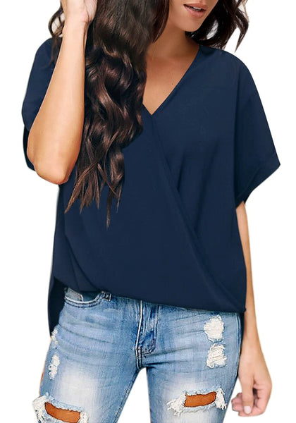 Model poses wearing navy V-neckline cuffed sleeves loose wrap blouse
