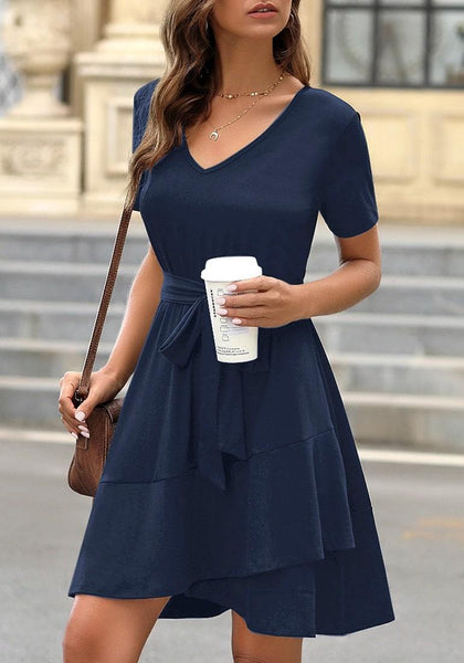 Model poses wearing navy V-neckline short sleeves belted ruffle dress