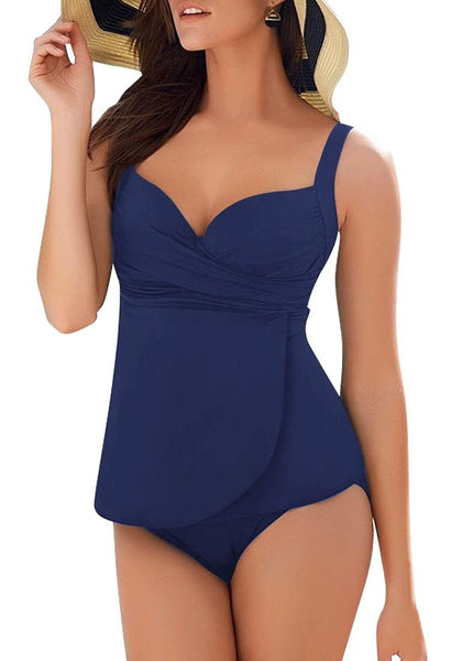 Model poses wearing navy blue cross wrap ruched sweetheart tankini set