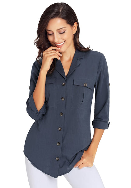 Model poses wearing navy blue long cuffed sleeves lapel button-up blouse