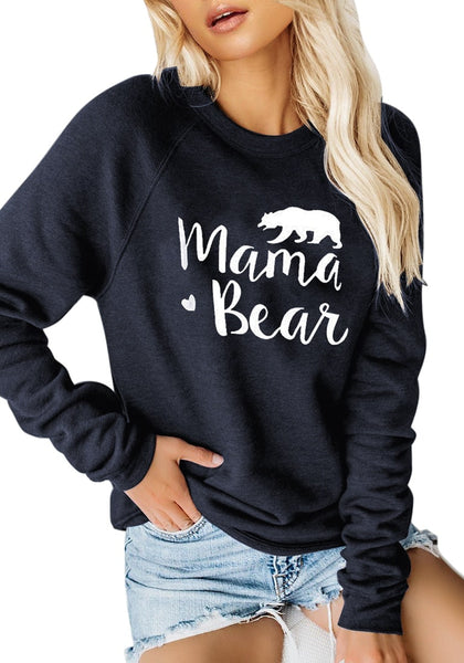 Model poses wearing navy blue statement print crewneck sweatshirt