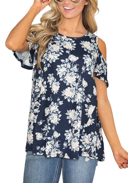 Model poses wearing navy floral cold-shoulder blouse
