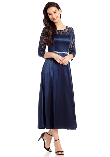 Model poses wearing navy lace-sleeve long satin dress