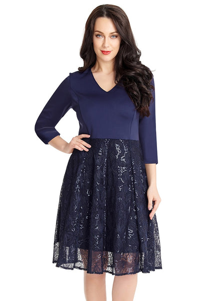 Model poses wearing navy matte sequins abstract mesh-bottom dress