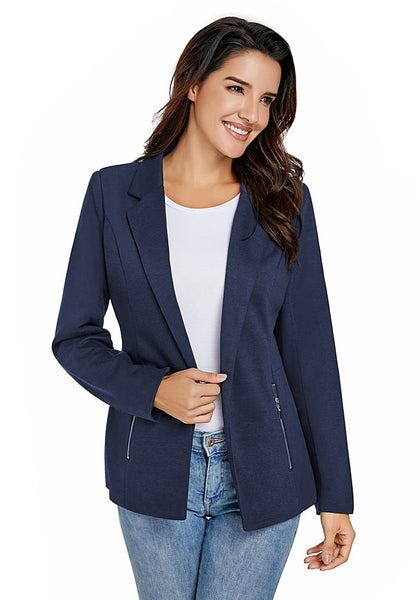 Model poses wearing navy notched lapel side zip blazer