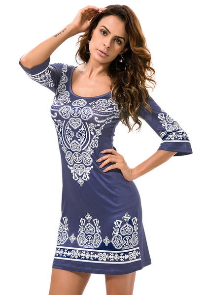 Model poses wearing navy paisley print dress