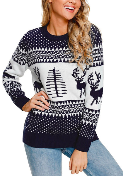 Model poses wearing navy reindeer and tree ugly Christmas sweater