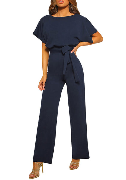 Model poses wearing navy short sleeves keyhole-back belted jumpsuit