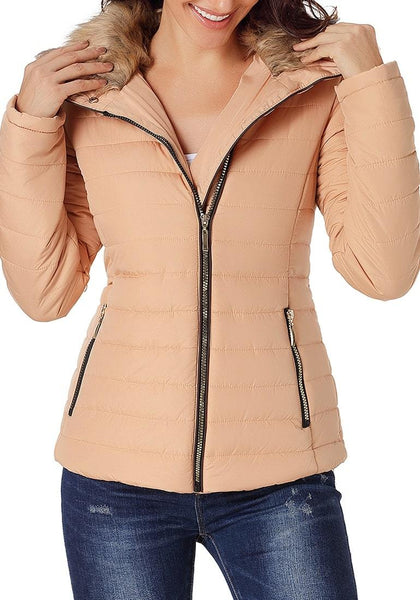 Model poses wearing peach faux fur collar zip up quilted jacket