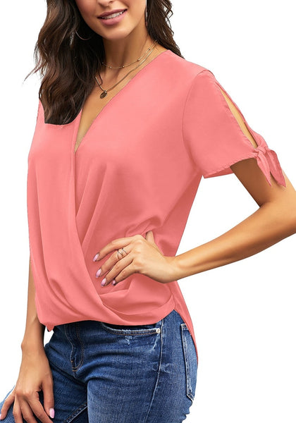Model poses wearing pink V-neck split tie sleeves loose surplice top