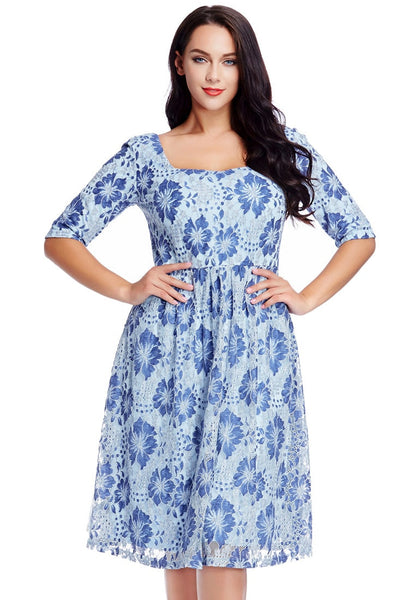 Model poses wearing plus size light blue floral-print lace dress