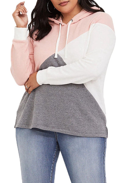 Model poses wearing plus size light pink color block drawstring hoodie