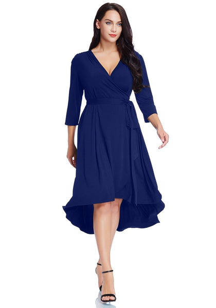 Model poses wearing plus size royal blue high-low wrap skater dress