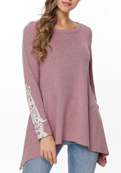 Model poses wearing rose pink crochet applique long sleeves asymmetrical top
