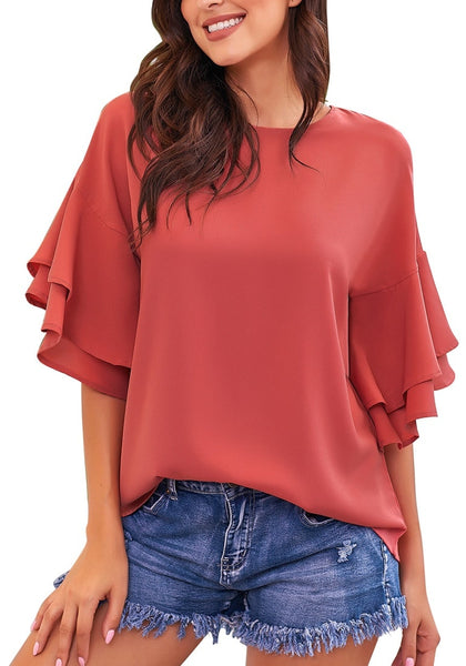 Model poses wearing rust red trumpet sleeves keyhole-back blouse