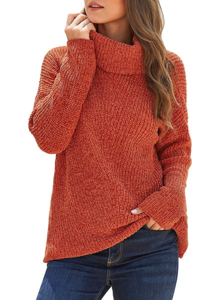 Model poses wearing rust turtleneck velvet cable knit pullover sweater