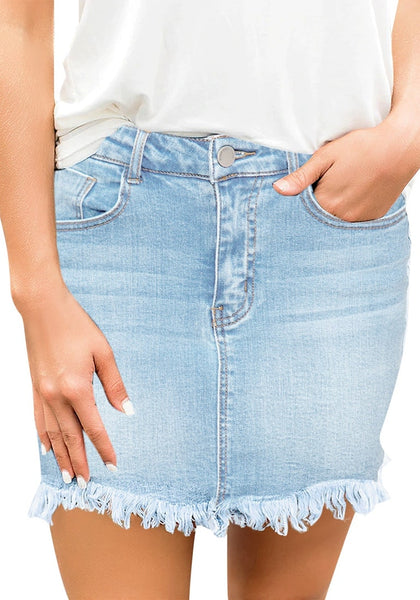 Model poses wearing sky blue frayed hem washed denim mini skirt