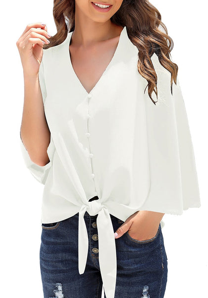 Model poses wearing white V-neckline button loop loose top