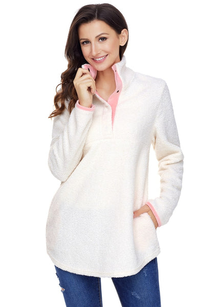 Model poses wearing white button-front fleece pullover