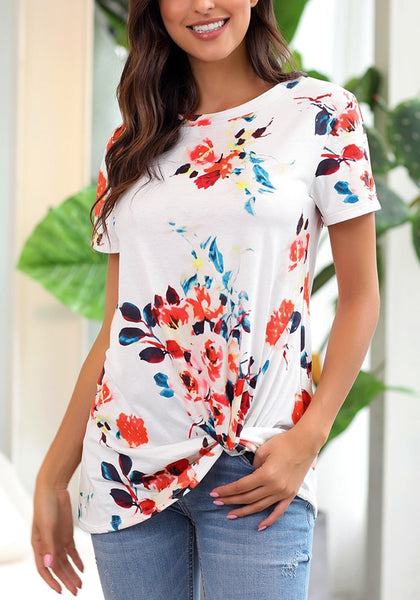 Model poses wearing white floral front twist knot short sleeves blouse.