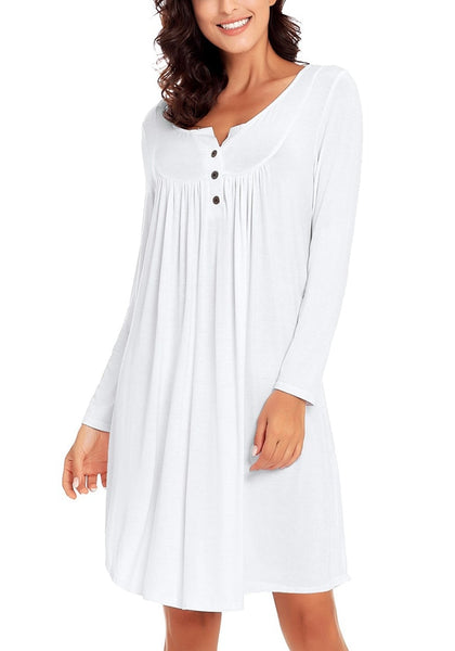 Model poses wearing white long sleeves curved hem henley dress