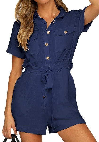 Model poses wearing white navy blue sleeves button-down belted romper