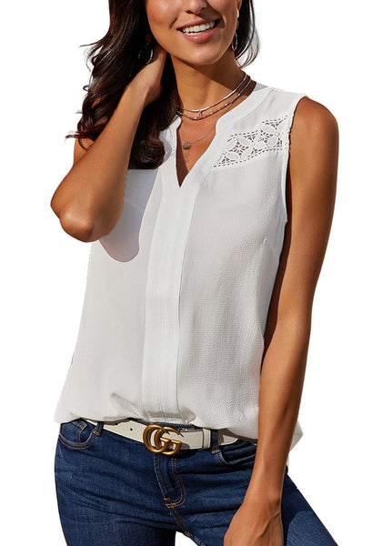 Model poses wearing white notched V-neck crochet lace sleeveless top