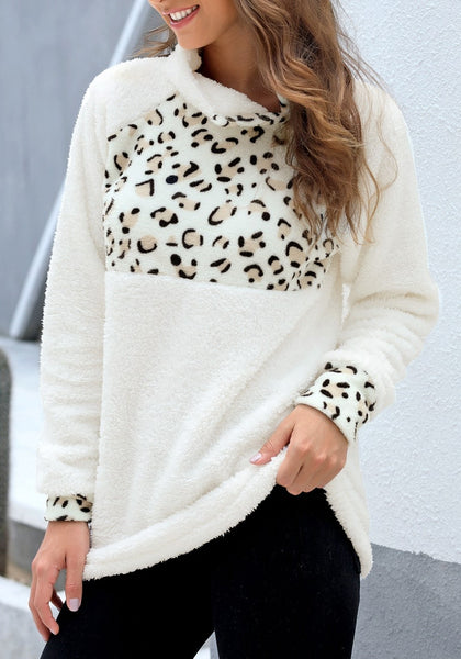 Model poses wearing white oblique stand collar leopard fleece pullover