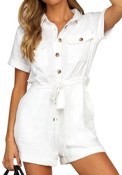 Model poses wearing white  short sleeves button-down belted romper