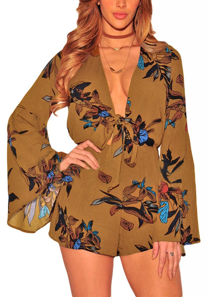 Model poses with one hand on the waist wearing brown floral print plunge romper