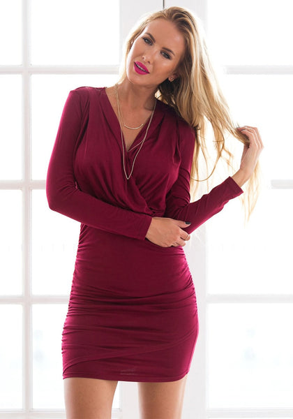 Model renee is wearing falu red ruched wrap-style dress