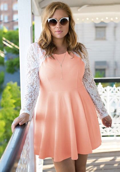 Model's front wearing an apricot lace sleeve skater dress