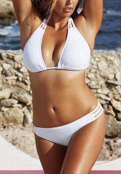 Model sizzles in white three-straps halter bikini set