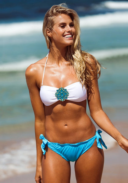 Model smiling in this totally rad two-piece swimwear