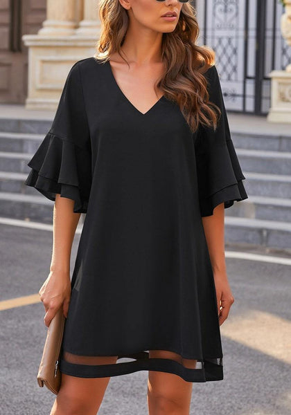 Model wearing black flare sleeves mesh panel V-neckline shift dress