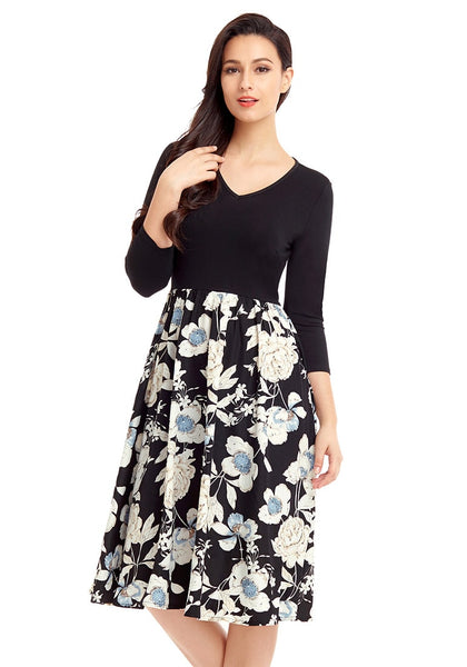 Model wearing black floral-bottom V neckline crop sleeves skater dress