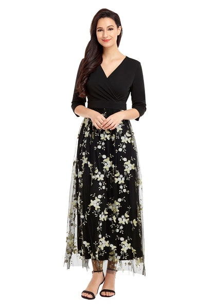 Model wearing black floral-embroidered mesh maxi dress